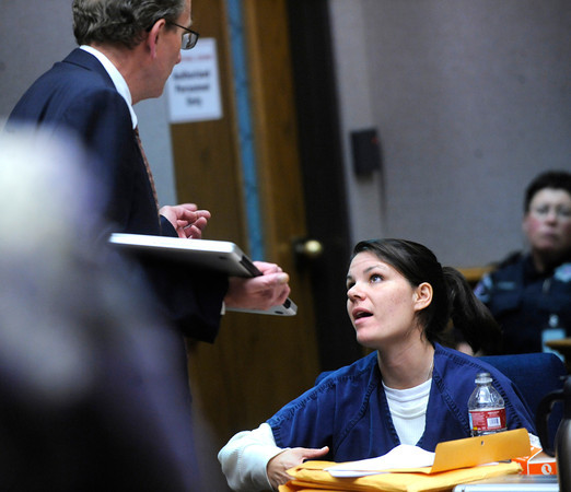 Molly Bowers, formerly Molly Midyette talks with her attorney Thomas Carberry as the court tries to figure out a schedule for upcoming testimony and trial dates.<br /> Photo by Paul Aiken