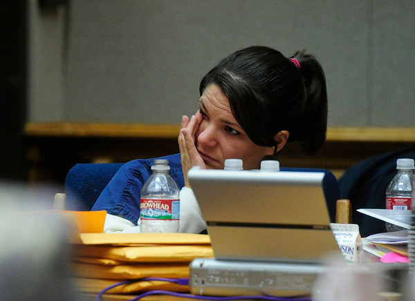 MIDYETTE<br /> Molly Midyette wipes tears from her eyes while listening to the testimony of her mother, Jane Bowers, during Midyette's hearing on Thursday.<br /> <br /> PHOTO BY MARTY CAIVANO<br /> OCT.28, 2011