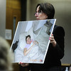 MIDYETTE<br /> Alison Ruttenberg, one of Molly Midyette's attorneys, shows Jane Bowers a photograph of Molly with baby Jason during Midyette's hearing on Friday.<br /> <br /> PHOTO BY MARTY CAIVANO<br /> OCT.28, 2011