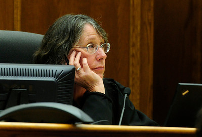 MIDYETTE Judge Lael Montgomery listens to testimony during Molly Midyette's hearing on Monday.  PHOTO BY MARTY CAIVANO OCT.24, 2011