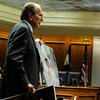 MIDYETTE<br /> Thomas Carberry, an attorney for Molly Midyette, shows photographs of Midyette with her baby to the prosecution before submitting them into evidence during Midyette's hearing on Monday.<br /> <br /> PHOTO BY MARTY CAIVANO<br /> OCT.24, 2011