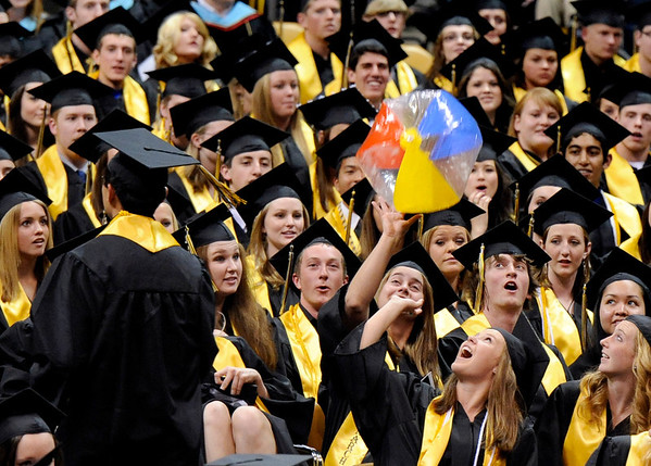 """Monarch High School graduates play with a beach ball during Monarch's graduation ceremony on Friday, May 20, at the Coors Events Center on the University of Colorado campus in Boulder. For more photos and video of the graduation go to  <a href=""""http://www.dailycamera.com"""">http://www.dailycamera.com</a><br /> Jeremy Papasso/ Camera"""