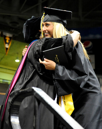 """Monarch High School graduate Tessa Cevaal, right, hugs principal Jerry Anderson after receiving her diploma during Monarch's graduation ceremony on Friday, May 20, at the Coors Events Center on the University of Colorado campus in Boulder. For more photos and video of the graduation go to  <a href=""""http://www.dailycamera.com"""">http://www.dailycamera.com</a><br /> Jeremy Papasso/ Camera"""