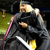 "Monarch High School graduate Tessa Cevaal, right, hugs principal Jerry Anderson after receiving her diploma during Monarch's graduation ceremony on Friday, May 20, at the Coors Events Center on the University of Colorado campus in Boulder. For more photos and video of the graduation go to  <a href=""http://www.dailycamera.com"">http://www.dailycamera.com</a><br /> Jeremy Papasso/ Camera"