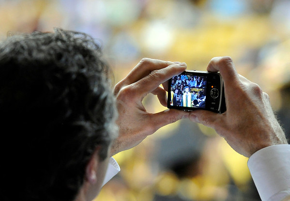 """Giovanni Ruscitti takes a photograph of his son and Monarch High School graduate Dante Ruscitti during Monarch's graduation ceremony on Friday, May 20, at the Coors Events Center on the University of Colorado campus in Boulder. For more photos and video of the graduation go to  <a href=""""http://www.dailycamera.com"""">http://www.dailycamera.com</a><br /> Jeremy Papasso/ Camera"""