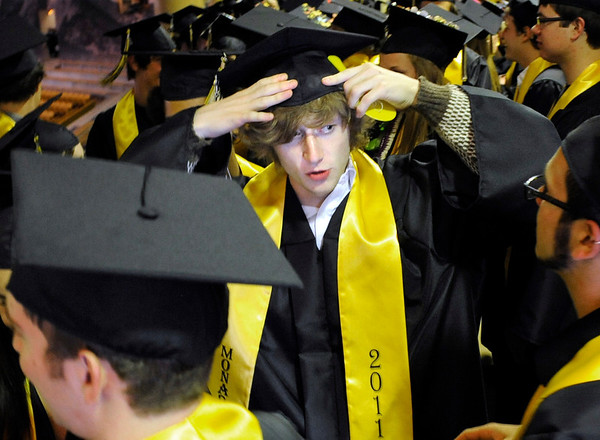 "Monarch High School graduate Hunter Bramblett fixes his cap during the start of Monarch's graduation ceremony on Friday, May 20, at the Coors Events Center on the University of Colorado campus in Boulder. For more photos and video of the graduation go to  <a href=""http://www.dailycamera.com"">http://www.dailycamera.com</a><br /> Jeremy Papasso/ Camera"