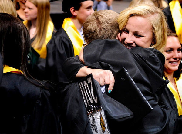 """Monarch High School graduate Haley Schumacher hugs her friend and fellow graduate Austin Roberts after Monarch's graduation ceremony on Friday, May 20, at the Coors Events Center on the University of Colorado campus in Boulder. For more photos and video of the graduation go to  <a href=""""http://www.dailycamera.com"""">http://www.dailycamera.com</a><br /> Jeremy Papasso/ Camera"""