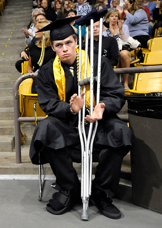 "Monarch High School graduate Fergus Sharp sits with his crutches during Monarch's graduation ceremony on Friday, May 20, at the Coors Events Center on the University of Colorado campus in Boulder.   Sharp was using crutches because of a broken ankle. For more photos and video of the graduation go to  <a href=""http://www.dailycamera.com"">http://www.dailycamera.com</a><br /> Jeremy Papasso/ Camera"