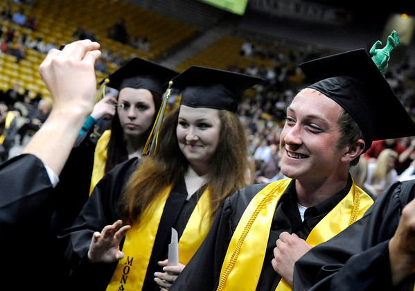 """Monarch High School graduate Alexander Krull, right, gets his picture taken by a fellow graduate during Monarch's graduation ceremony on Friday, May 20, at the Coors Events Center on the University of Colorado campus in Boulder. For more photos and video of the graduation go to  <a href=""""http://www.dailycamera.com"""">http://www.dailycamera.com</a><br /> Jeremy Papasso/ Camera"""