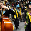 "Monarch High School graduate  Alexa Orr, right, walks past the band while heading to her seat during Monarch's graduation ceremony on Friday, May 20, at the Coors Events Center on the University of Colorado campus in Boulder. For more photos and video of the graduation go to  <a href=""http://www.dailycamera.com"">http://www.dailycamera.com</a><br /> Jeremy Papasso/ Camera"
