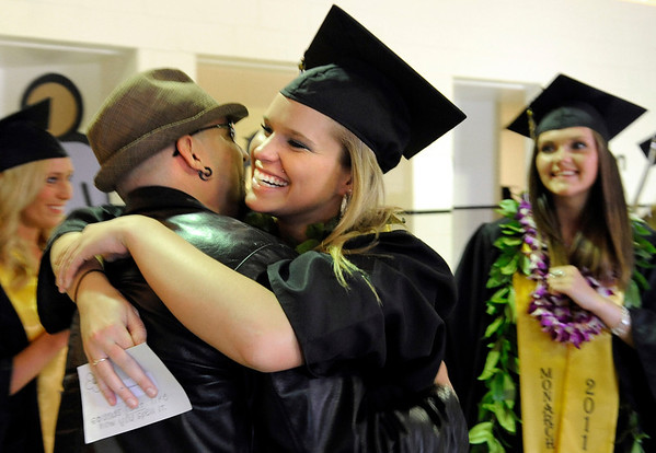"Monarch High School graduate Lisa Muchmore hugs her middle school teacher Dewey Espinosa during Monarch's graduation ceremony on Friday, May 20, at the Coors Events Center on the University of Colorado campus in Boulder. For more photos and video of the graduation go to  <a href=""http://www.dailycamera.com"">http://www.dailycamera.com</a><br /> Jeremy Papasso/ Camera"