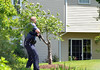 A police officer responding to a shooting walks near a residence on Harvard Drive Montgomery Township prior to arrival of tactical team.    Monday, June 2, 2014.  Photo by Geoff Patton
