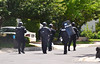 Members of a  tactical response team walk on Havard Drive in Montgomery Township following a shooting.  Monday, June 2, 2014.  Photo by Geoff Patton