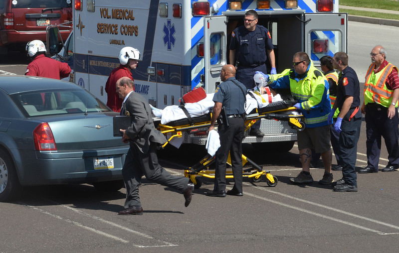 A person injured in a shooting is moved from an ambulance to a medical helicolpter in Montgomery Township.   Monday,  June 2, 2014.   Photo by Geoff Patton