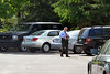 A police officer stands in Harvard Drive in Montgomery Township shortly after shooting victim was taken from the area.   Monday,  June 2, 2014.   Photo by Geoff Patton