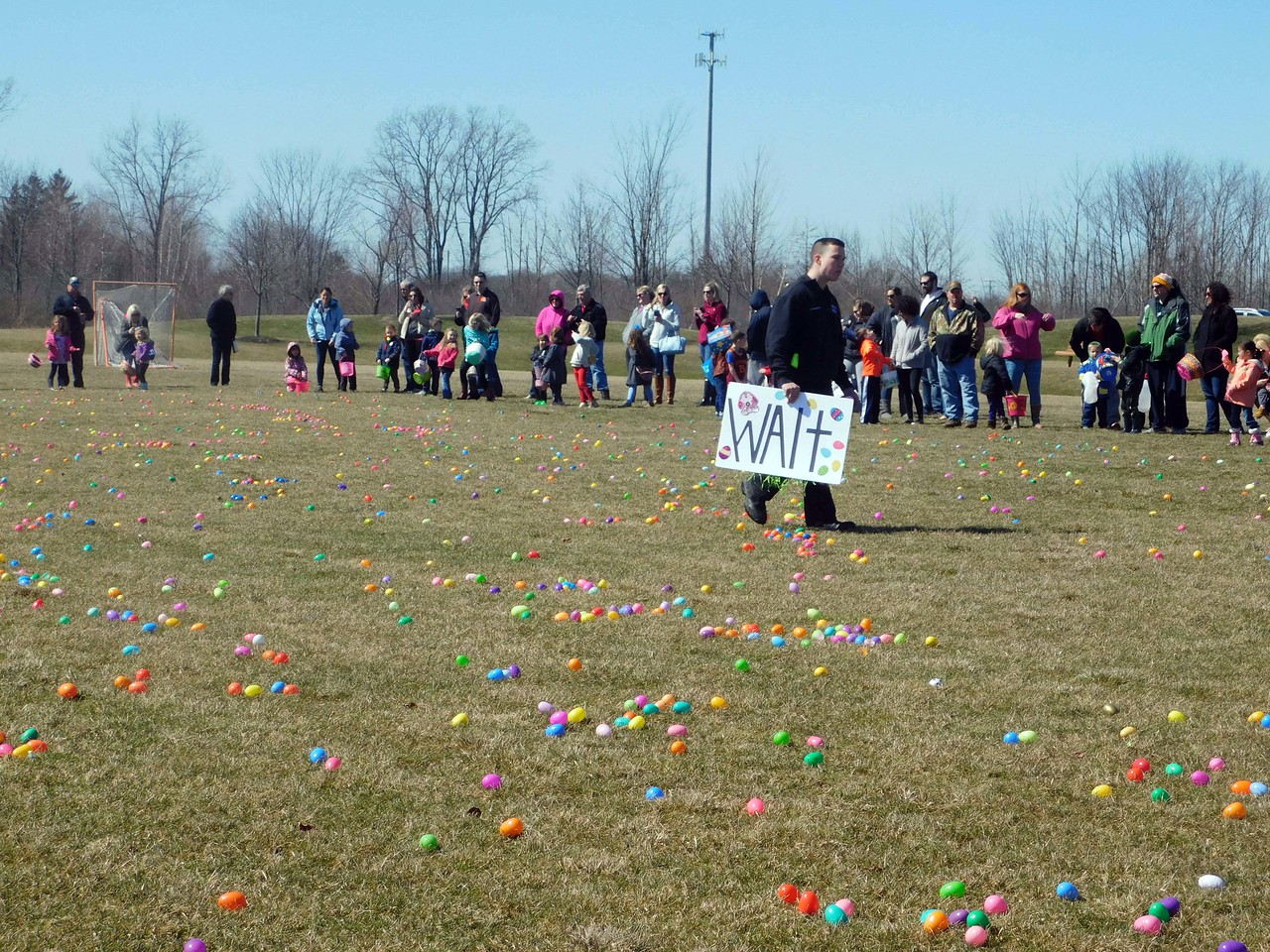 NATHAN HAVENNER / GAZETTE Children wait with their parents for the Montville Township Easter Egg Hunt to begin Sunday afternoon at Cobblestone Park.