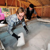"""Jane Curtis Gazit, of Keep Magnolia Clean, LLC, left, and her partner Michael Wooten work together while putting dry ice into the freezer that holds the casket of Grandpa """"Bredo Morstoel"""" on Monday, Oct. 22, in Nederland. For a video on how Grandpa Bredo Morstoel is kept frozen go to  <a href=""""http://www.dailycamera.com"""">http://www.dailycamera.com</a><br /> Jeremy Papasso/ Camera"""