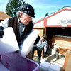 """Michael Wooten, left, grabs blocks of dry ice from a truck while working with Jane Curtis Gazit, center, to put dry ice into the freezer that holds the casket of Grandpa """"Bredo Morstoel"""" on Monday, Oct. 22, in Nederland. For a video on how Grandpa Bredo Morstoel is kept frozen go to  <a href=""""http://www.dailycamera.com"""">http://www.dailycamera.com</a><br /> Jeremy Papasso/ Camera"""