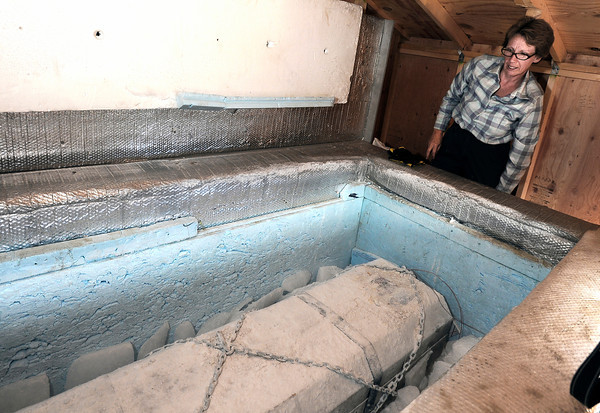 "Jane Curtis Gazit, with Keep Magnolia Clean, LLC, lifts the lid to the casket while putting dry ice into the freezer that holds Grandpa ""Bredo Morstoel"" on Monday, Oct. 22, in Nederland. For a video on how Grandpa Bredo Morstoel is kept frozen go to  <a href=""http://www.dailycamera.com"">http://www.dailycamera.com</a><br /> Jeremy Papasso/ Camera"