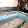 """Jane Curtis Gazit, with Keep Magnolia Clean, LLC, lifts the lid to the casket while putting dry ice into the freezer that holds Grandpa """"Bredo Morstoel"""" on Monday, Oct. 22, in Nederland. For a video on how Grandpa Bredo Morstoel is kept frozen go to  <a href=""""http://www.dailycamera.com"""">http://www.dailycamera.com</a><br /> Jeremy Papasso/ Camera"""