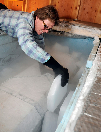 "Jane Curtis Gazit, of Keep Magnolia Clean, LLC, packs the cooler with dry ice to ensure that Grandpa ""Bredo Morstoel"" stays frozen on Monday, Oct. 22, in Nederland. For a video on how Grandpa Bredo Morstoel is kept frozen go to  <a href=""http://www.dailycamera.com"">http://www.dailycamera.com</a><br /> Jeremy Papasso/ Camera"