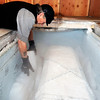 """Michael Wooten works to put dry ice next to a casket to ensure Grandpa """"Bredo Morstoel"""" stays frozen on Monday, Oct. 22, in Nederland. For a video on how Grandpa Bredo Morstoel is kept frozen go to  <a href=""""http://www.dailycamera.com"""">http://www.dailycamera.com</a><br /> Jeremy Papasso/ Camera"""