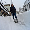 KRISTOPHER RADDER - BRATTLEBORO REFORMER<br /> Percy Sutton, of Barrington, R.I., walks through paths in the snow in downtown Wilmington, Vt., on Thursday, March 8, 2018.