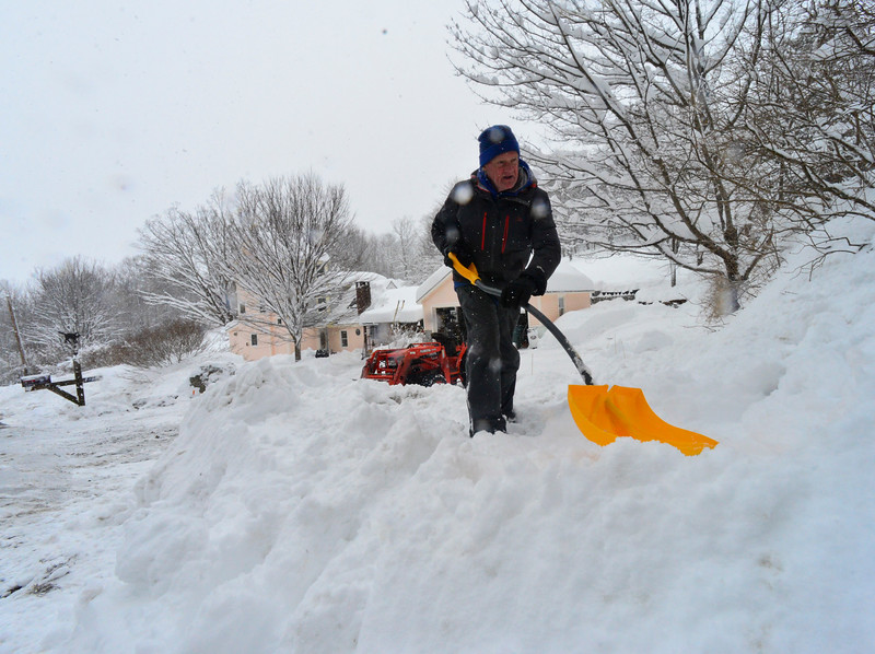 KRISTOPHER RADDER - BRATTLEBORO REFORMER<br /> Tom Gleason, of Wilmington, removes some of the snow from the mouth of his driveway to get a better view when leaving on Thursday, March 8, 2018.