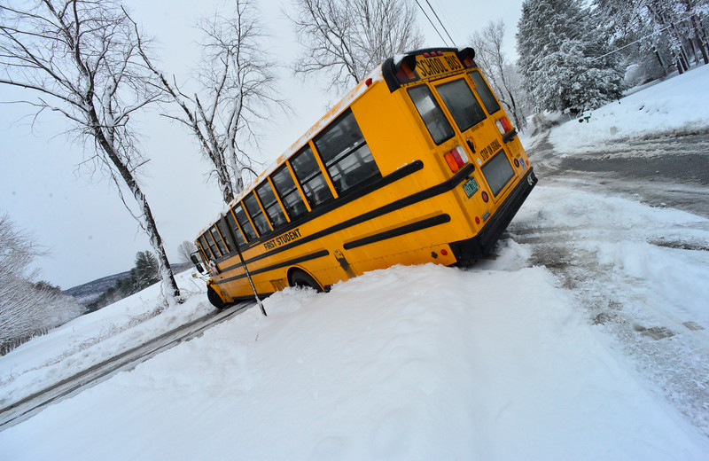 KRISTOPHER RADDER - BRATTLEBORO REFORMER<br /> A school bus on East Orchard Street got stuck in a ditch while trying to turn around on Thursday, March 8, 2018. No children were  on the bus. Two school buses became stuck in the snow while traveling to pick up students.