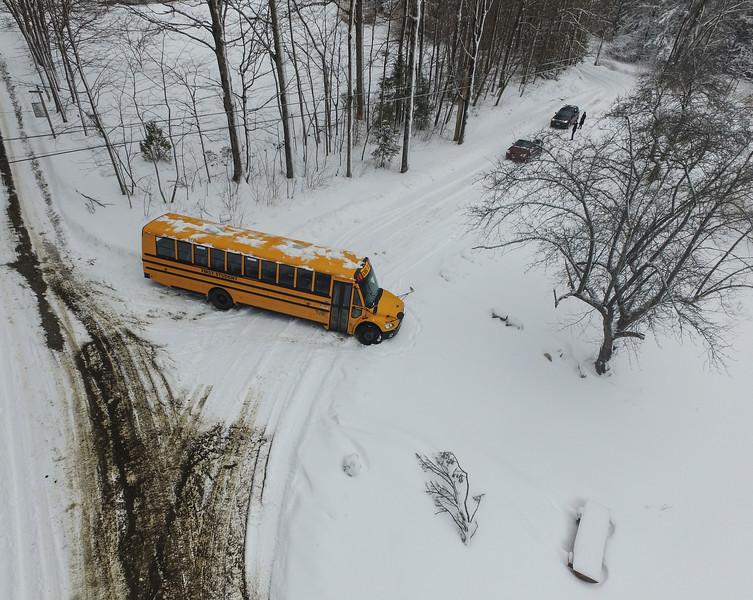 KRISTOPHER RADDER - BRATTLEBORO REFORMER<br /> A school bus got stuck in the snow at the intersection of Bonnyvale Road and Miller Road, in Brattleboro, on Thursday, March 8, 2018. <br /> <br /> Rebecca Snow, of Brattleboro, was traveling up Bonnyvale Road with her children taking them to school. She said they had a few incidents in the car where it was sliding sideways in the snow. As she traversed the snow-covered road, she had to stop because of the bus that was stuck in the snow.