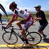 MORGUL<br /> Men's pro winner Nate Wilson gets a push from a volunteer after crossing the finish line at the Morgul Bismarck circuit race at the Superior Morgul Classic in Superior on Sunday.<br /> Photo by Marty Caivano/May 29, 2011