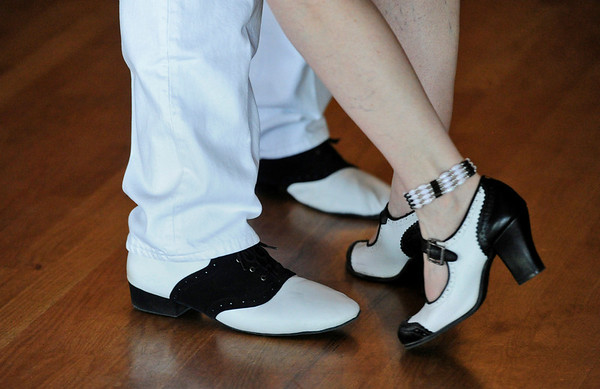 MOTHERS<br /> A couple sports matching shoes at a Mother's Day tea dance held at the Avalon Ballroom in Boulder on Sunday.<br /> Photo by Marty Caivano/May 8, 2011