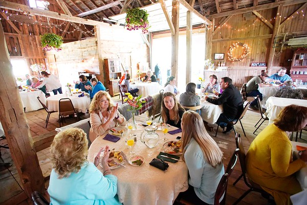 BEN GARVER — THE BERKSHIRE EAGLE<br /> Holiday Brook Farm hosts a Mother's Day brunch in Cooper Barn complete with music and a ride to the barn on farm wagon pulled by tractor.