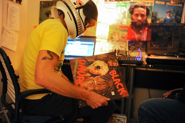 """Radio_5.jpg Jeep MacNichol chooses what record to play next as he broadcasts a weekly reggae pirate radio show called Mr. Anonymous Internet Radio on Monday, December 10, 2012 at his Denver home. Listeners can find him and his co-host, James """"Butchy"""" Stapleton, them online or broadcasted by Boulder's Green Light Radio. The duo has followers from around the world and play records from MacNichol's personal collection that he has been working on since he was in the eighth grade. (Kira Horvath/Longmont Times-Call)"""
