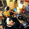"Radio_13.jpg Jeep MacNichol, back, and James ""Butchy"" Stapleton broadcast a weekly reggae pirate radio show called Mr. Anonymous Internet Radio Monday evenings from 5-7 at MacNichol's Denver home. Listeners can find them online or broadcasted by Boulder's Green Light Radio. The duo has followers from around the world and play records from MacNichol's personal collection that he has been working on since he was in the eighth grade. (Kira Horvath/Longmont Times-Call)"