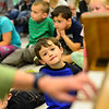"KRISTOPHER RADDER - BRATTLEBORO REFORMER<br /> Jonny Kerber, a pre-kindergarten at Guilford Central School, watches as Ellen Rowe, a music professor at the University of Michigan, plays a jazzy version of ""Working on the Railroad,"" during a visit to the school on Tuesday, May 22, 2018."