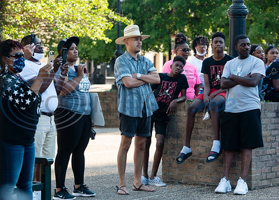 People attend a press conference held by the NAACP Branch #6232 Tyler to discuss the chapter's position on racial issues on the downtown square in Tyler on Wednesday, June 3, 2020.