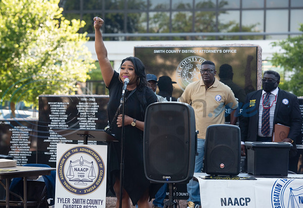 Ashley Amie, NAACP Tyler Youth Director, symbolically holds up her first during a press conference held by the NAACP Branch #6232 Tyler to discuss the chapter's position on racial issues on the downtown square in Tyler on Wednesday, June 3, 2020.