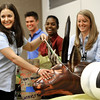 "Erika Schmitmeyer, an intern with Ball Aerospace, shows off the moose payload her and her team used as part of an rocket payload experiment during a presentation for the visit of NASA Deputy Administrator Lori Garver,  on Tuesday, July 26.<br /> For more photos and a video of the event go to  <a href=""http://www.dailycamera.com"">http://www.dailycamera.com</a><br /> Photo by Paul Aiken / The Camera / July 26, 2011"