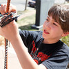 "Nelson Walker, 11, left, assembles his art piece at The Dairy Center for the Arts, Friday, March. 30th, 2012, Boulder. Walkers art will be on display throughout out the summer. <br /> For video and more photos visit  <a href=""http://www.dailycamera.com"">http://www.dailycamera.com</a><br /> By Derek Broussard"