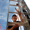 "Nelson Walker, 11, left, assembles his art piece at The Dairy Center for the Arts with the help of his father, Jim Walker, right, Friday, March. 30th, 2012, Boulder. Walkers art will be on display throughout out the summer. <br /> For video and more photos visit  <a href=""http://www.dailycamera.com"">http://www.dailycamera.com</a><br /> By Derek Broussard"