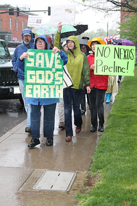 LAWRENCE PANTAGES / GAZETTE A group of about 50 protesters march around Public Square on Saturday in Medina. The rally, organized by the citizens group Sustainable Medina County, sought to raise awareness of environmental issues.