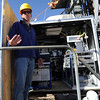 "Project Scientist, Steve Brown, talks about the instruments in the carrier.<br /> NOAA is using their Erie tower to study the effects of nitryl chloride on the atmosphere during the nighttime of winter.<br /> For a video and photos of the NOAA press briefing, go to  <a href=""http://www.dailycamera.com"">http://www.dailycamera.com</a>.<br /> Cliff Grassmick/ March 1, 2011"