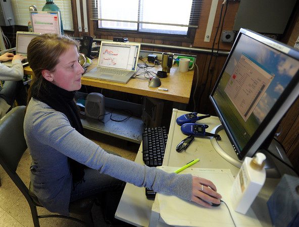 """Cora Young monitors the progress of the instrument elevator.<br /> NOAA is using their Erie tower to study the effects of nitryl chloride on the atmosphere during the nighttime of winter.<br /> For a video and photos  of the NOAA press briefing, go to  <a href=""""http://www.dailycamera.com"""">http://www.dailycamera.com</a>.<br /> Cliff Grassmick/ March 1, 2011"""