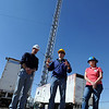 "Project scientists, Jim Roberts, left, Steve Brown and Ann Middlebrook, explain the nature of the project.<br /> NOAA is using their Erie tower to study the effects of nitryl chloride on the atmosphere during the nighttime of winter.<br /> For a video and photos of the NOAA press briefing, go to  <a href=""http://www.dailycamera.com"">http://www.dailycamera.com</a>.<br /> Cliff Grassmick/ March 1, 2011"