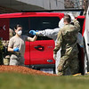 Palm Center nursing home in Chelmsford, where the National Guard was deployed to conduct coronavirus COVID-19 testing after numerous residents tested positive. National Guard members disinfect each other and get out of their protective suits. (SUN/Julia Malakie)