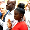 BEN GARVER — THE BERKSHIRE EAGLE<br /> Korpo Harris from Liberia takes her oath  of citizenship from Judge Joan McMenemy during the Naturalization Ceremony at the Norman Rockwell Museum in Stockbridge, Mass., Friday June 14, 2019.