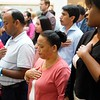 BEN GARVER — THE BERKSHIRE EAGLE<br /> People from around the world listen to the Nathional Anthem during the Naturalization Ceremony at the Norman Rockwell Museum in Stockbridge, Mass., Friday June 14, 2019.