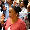 BEN GARVER — THE BERKSHIRE EAGLE<br /> Nar Maya Biswa from Bhutan takes her oath of citizenship from Judge Joan McMenemy during the naturalization Ceremony at the Norman Rockwell Museum in Stockbridge, Friday June 14, 2019.