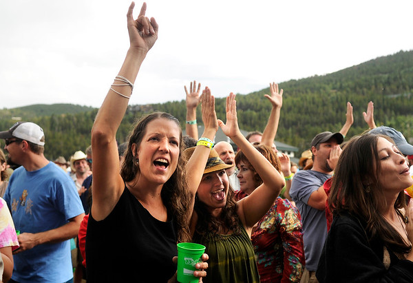 "Jelena Caplan, of Lyons, at left, and Kristina Dusevic, of Littleton, middle, show their support for bluegrass music during the NedFest music festival on Saturday, Aug. 27, in Nederland. For more photos and video of the event go to  <a href=""http://www.dailycamera.com"">http://www.dailycamera.com</a><br /> Jeremy Papasso/ Camera"